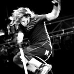 Anthony Kiedis black & white photo of him jumping on stage