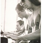 Anthony Kiedis black & white photo from Kerrang legends with RHCP Flea and Frusicante playing the piano