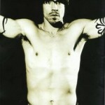 Anthony Kiedis black & white topless with arms outstretched