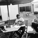 Anthony Kiedis black & white writing at a table