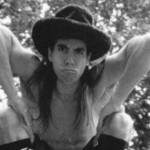 Anthony Kiedis black & whitephoto of him wearing a hat and pointing downwards