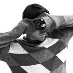 Anthony Kiedis wearing a diamond jumper sweater taking a photo black & white