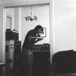 Anthony Kiedis black & white photo of him eating in the studio at the Chateau Marmont