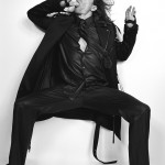 Anthony Kiedis black & white photo of him in a suit sucking his thumb