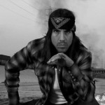 Anthony Kiedis black & white photo of him looking mean wearing a head scarf