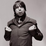Anthony Kiedis black & white photo of him puffing out his chest