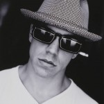 Anthony Kiedis black & white photo of him in a pork pie hat