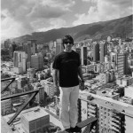 Anthony Kiedis black & white photo of him in Caracas standing on edge of skyscrapper roof