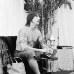 Anthony Kiedis black & white photo of him at table