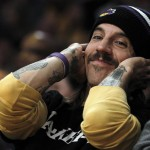 Beautiful Anthony Kiedis Lakers game LA holding head