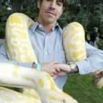 Anthony Kiedis with an albino python snke