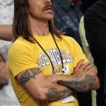 Anthony Kiedis Lakers game LA arms crossed in yellow t-shirt