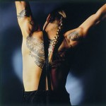 Anthony Kiedis with ponytail back tattoo of tribal motif