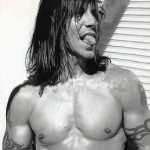 Anthony Kiedis topless with tongue sticking out gorgeous