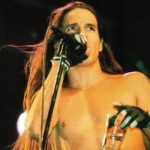 Anthony Kiedis topless on stage holding glass