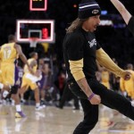 Anthony Kiedis Lakers game LA kicking on court