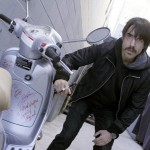 Anthony Kiedis signing autograph on motorbike moped