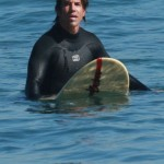 anthony kiedis sitting on surfboard ocean