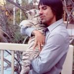 Anthony Kiedis cuddling a white tiger cub