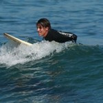 anthony kiedis sitting on surfboard sea