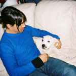 Anthony Kiedis with a white dog