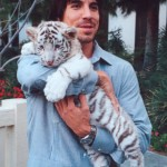 Anthony Kiedis with a white tiger cub