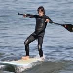anthony kiedis wetsuit paddling surfboard