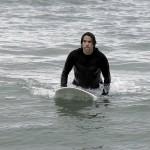 anthony kiedis holding surfboard ocean