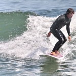 anthony kiedis standing on surfboard ocean foam