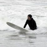 anthony kiedis holding on surfboard sea