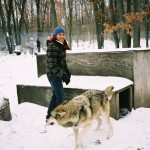Anthony Kiedis with a wolf in the snow at the wolf reserve