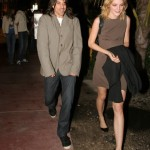 anthony Kiedis and Jessica Stam holding black coat