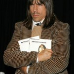 Scar Tissue by Anthony Kiedis AK holding book and frowning