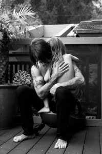 anthony kiedis cuddling everly near black white