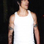 Photo taken by Blackie Dammett of Anthony Kiedis wearing a white vest t-shirt