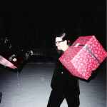 Photo taken by Blackie Dammett of Anthony Kiedis at Christmas with huge present