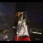 Anthony Kiedis singing pose live on stage