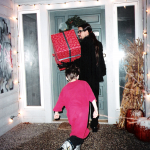 Photo taken by Blackie Dammett of Anthony Kiedis Christmas with Jamie and present