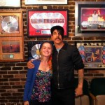 Anthony Kiedis poses with fan for photo