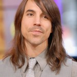 Anthony Kiedis Red Hot Chili Peppers gray suit and tie