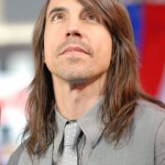 Anthony Kiedis Red Hot Chili Peppers grey suit and tie