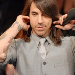 Anthony Kiedis Red Hot Chili Peppers grey suit and tie ear phones