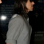 Anthony Kiedis Red Hot Chili Peppers gray suit and tie And shades