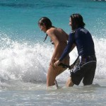 anthony-kiedis-heather-christie-walking-pulling-down-bikini