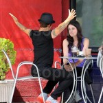 anthony kiedis arms outstretched with girlfriend