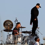 anthony Kiedis standing on drum kit singing on rooftop with RHCP in Muscle Beach California