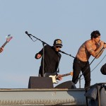bare chested anthony Kiedis singing on rooftop with RHCP in Muscle Beach California