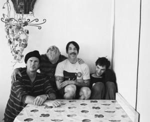 anthony kiedis sseated at table with new RHCP line up
