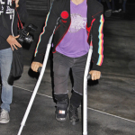 Anthony Kiedis foot injury crutches arriving Lakers game