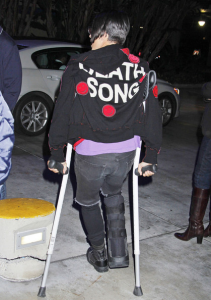 Anthony Kiedis back view crutches Lakers game Death Song jacket